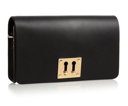 Sophie Hulme Twin Keyhole leather clutch, $445