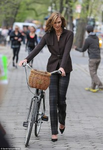 Karlie Kloss is not only a tall woman who wears heels, she also bikes in them.  Badass, kids.  via DailyMail