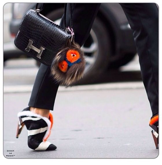 Fendi heels & buggy on Hermes bag.