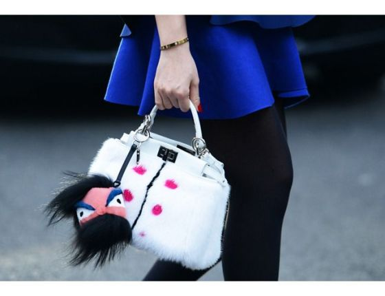 Fendi buggy on a Fendi bag, photographed by Tommy Ton.
