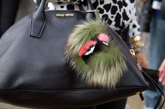 Fendi buggy on a Miu Miu bag.